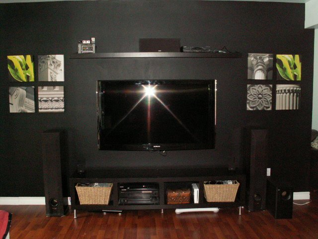 painting a black feature wall camouflage your tv with